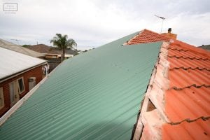Tile to metal roof conversion